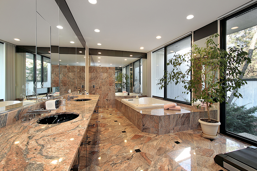 Master bath in luxury home with marble floors and counters